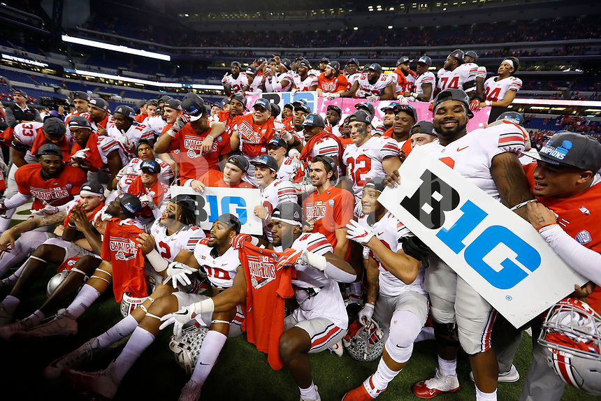 Ohio State Buckeyes players celebrate following their 27-21 win over the Wisconsin Badgers in the Big Ten championship football game at Lucas Oil Stadium in Indianapolis on Dec. 2, 2017. [Adam Cairns / Dispatch]