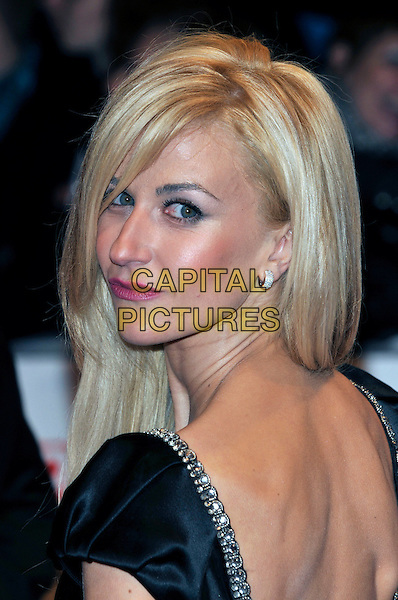 KATHERINE KELLY.The 15th National Television Awards held at the O2 Arena, London, England..January 20th, 2010.NTA NTAs headshot portrait black looking over shoulder .CAP/PL.©Phil Loftus/Capital Pictures.