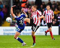 Lincoln City's Harry Anderson is fouled by Chesterfield's Louis Reed<br /> <br /> Photographer Andrew Vaughan/CameraSport<br /> <br /> The EFL Sky Bet League Two - Lincoln City v Chesterfield - Saturday 7th October 2017 - Sincil Bank - Lincoln<br /> <br /> World Copyright &copy; 2017 CameraSport. All rights reserved. 43 Linden Ave. Countesthorpe. Leicester. England. LE8 5PG - Tel: +44 (0) 116 277 4147 - admin@camerasport.com - www.camerasport.com