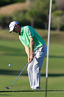 Michael Hoey (NIR) chips onto the 7th green during Thursday's Round 1 of the 2016 Portugal Masters held at the Oceanico Victoria Golf Course, Vilamoura, Algarve, Portugal. 19th October 2016.<br /> Picture: Eoin Clarke   Golffile<br /> <br /> <br /> All photos usage must carry mandatory copyright credit (© Golffile   Eoin Clarke)
