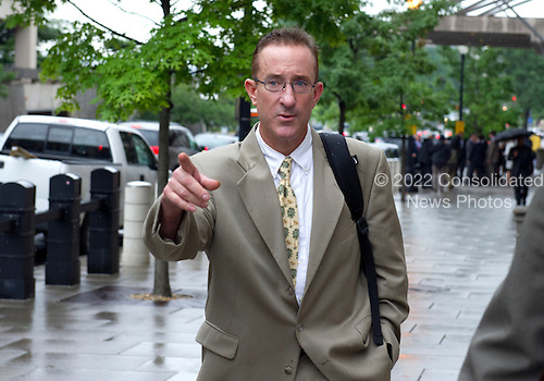 Brian McNamee gestures towards the photographers as he departs U.S. District Court in Washington, D.C. following his first day of testimony against former New York Yankee pitcher Roger Clemens on Monday, May 14, 2012..Credit: Ron Sachs / CNP.(RESTRICTION: NO New York or New Jersey Newspapers or newspapers within a 75 mile radius of New York City)