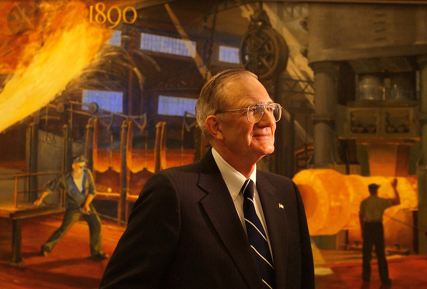 "STEEL:  Bethlehem Steel former CEO  C. ""Hank"" Barnette stands in front of a painting depicting Bessemer steel making at the 1st forge of Bethlehem Steel  back in the 1890's     ( CHUCK ZOVKO/  TMC)"