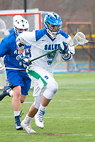 Eric Backus,'17, moves into position as the Seahawks battle Roger Williams in Men's Lacrosse game action at Gaudet Field in Middletown.