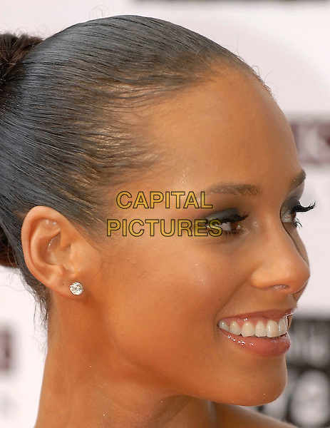 ALICIA KEYS.Guests arrive at the Black Ball UK in aid of the Keep A Child Alive HIV/AIDS charity at St John's, Smith Square, London, England, July 10, 2008..portrait headshot diamond earring profile .CAP/IA.©Ian Allis/Capital Pictures