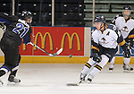 SIOUX FALLS, SD - JANUARY 1: Jimmy Mullin #21 from the Fargo Force has his shot deflected by Nolan Youngmun #25 of the Sioux Falls Stampede in the first period of their game Saturday night at the Arena. (Photo by Dave Eggen/Inertia)