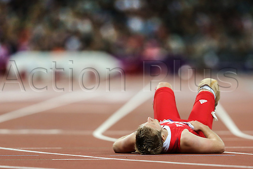 01.09.2012 London, England. mens 200m t-44 heat 2/3 C Bausch collapses on his back by the finish line during Day 3 of the London 2012 Paralympic Games at the Olympic Staduim in Stratford