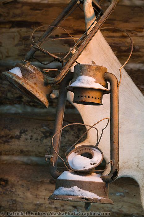 Relic lanterns and log cabin, Wiseman, Alaska