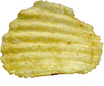 close up of ridged ruffle potato chip on shadowless white background