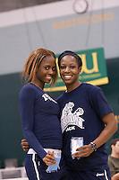 Lincoln's Anna-Kay James (left) and  Shakeisha Miller pause after receving their 1st and 3rd place medals at the 2012 MIAA Indoor Track & Field Championships at Missouri Southern in Joplin, Sunday, February 26. Lincoln's Ravel Grey (right) was second in 6.82, Missouri Southern freshman Jeff Fraley (in yellow) was third in a school record of 6.83, while SBU's Deneko Brown was 8th overall in the two section race.