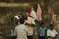 A outdoor Mumbai barbershop, central Mumbai,India