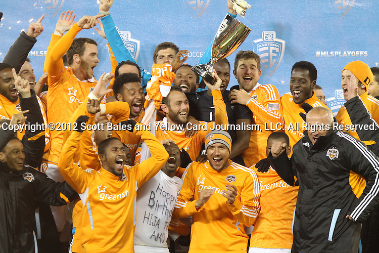 18 November 2012:  Houston's Brad Davis (center) holds the Eastern Conference Championship Trophy overhead as he celebrates with teammates. DC United tied the Houston Dynamo 1-1 at RFK Stadium in Washington, DC in the second leg of their 2012 MLS Cup Playoffs Eastern Conference Final series. Houston advanced to MLS Cup 2012 on aggregate goals, 4-2.