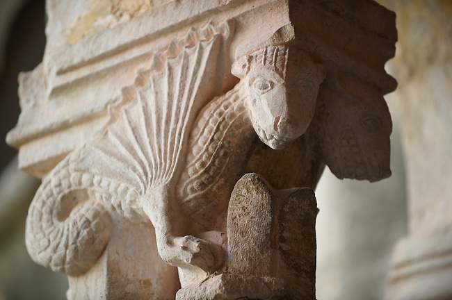 Stock photos of Sculptured dragon historiated Romanesque column Capitals - Franciscan Monatery cloisters - Dubrovnik