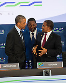 President Barack Obama chats with Benin President Boni Yayi (Center) and Tanzanian President Jakaya Mrisho Kikwete before participating in ìLeaders Session Three: Governing the Next Generation,î during the Africa Leaders Summit at the State Department in Washington, DC, August 6, 2014.  Obama is promoting business relationships between the United States and African countries during the three-day U.S.-Africa Leaders Summit, where 49 heads of state are meeting in Washington.  UPI/Molly Riley<br /> Credit: Molly Riley / Pool via CNP