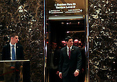 Speaker of the United States House of Representatives Paul Ryan (Republican of Wisconsin) exits the elevator after meetings with US President-elect Donald Trump, in the lobby of the Trump Tower, New York, New York, December 9, 2016.<br /> Credit: Aude Guerrucci / Pool via CNP