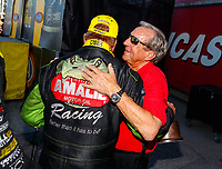 Oct 29, 2017; Las Vegas, NV, USA; NHRA top fuel driver Terry McMillen (left) is congratulated by Don Schumacher as he celebrates after winning the Toyota National at The Strip at Las Vegas Motor Speedway. Mandatory Credit: Mark J. Rebilas-USA TODAY Sports