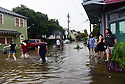 Heavy rains flooded streets in the historic Faubourg Marigny after city pumps were overwhelmed. sending tourists scurrying for dry land, New Orleans, Sat., Aug. 5, 2017. (Photo by Cheryl Gerber)