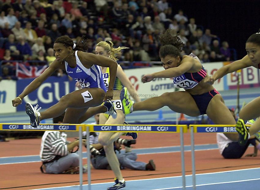 Photo. Richard Lane.CGI Indoor Grand Prix Athletics, NIA, Birmingham.20/2/2000. .Cuba hurdler, Aliuska Lopez  out hurdles Diane Allahgreen of Great Britain.