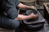Japan, Mie Prefecture, Iga City. Family run Iga pottery studio, at least eight generations. Iga pottery is a special style using local hard clay with a high resistance to fire. Male potter working at the studio. Making big pots to cook rice. Model released.