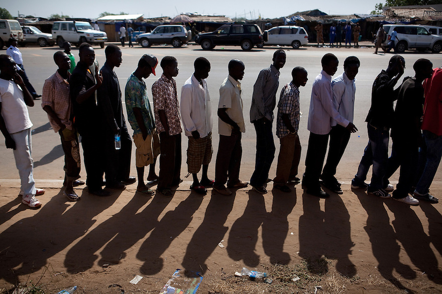 Sunday 9 january 2011 - Juba, Sudan - Southern Sudaneses line up to cast their vote at the John Garang memorial mausoleum where a polling station is being set up in Juba. About four million Southern Sudanese voters began casting their ballots Sunday in a weeklong referendum on independence that is expected to split Africa's largest nation in two. Photo credit: Benedicte Desrus