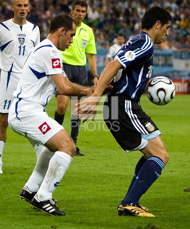 Albert Jadj (left)of Serbia & Montenegro in action against Juan Riquelme (right) of Argentina. Argentina defeated Serbia and Montenegro 6-0 in their FIFA World Cup Group C match at FIFA World Cup Stadium, Gelsenkirchen, Germany, June 16, 2006.