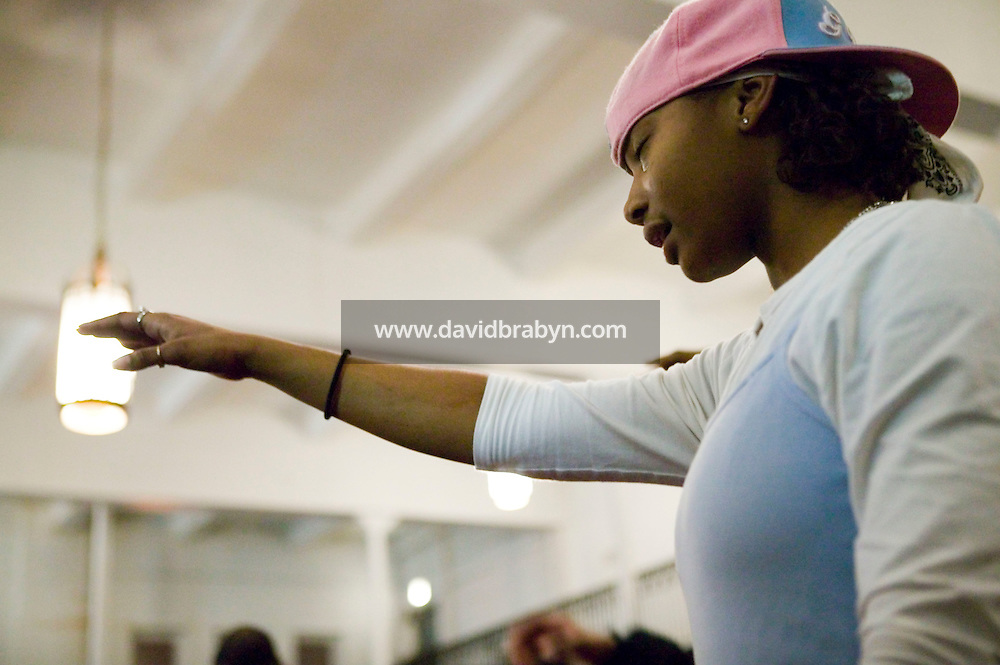 New York, USA - Jasmin Shand, 16, prays during mass at the Greater Hood Memorial AME Zion Church, home of the Hip-Hop Church, in Harlem, New York, USA, 17 February 2005. Photo Credit: David Brabyn.