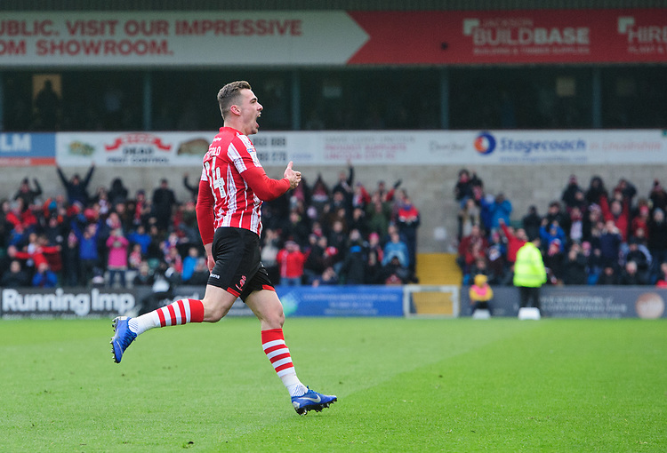 Lincoln City's Harry Toffolo celebrates scoring the opening goal<br /> <br /> Photographer Chris Vaughan/CameraSport<br /> <br /> The EFL Sky Bet League Two - Lincoln City v Grimsby Town - Saturday 19 January 2019 - Sincil Bank - Lincoln<br /> <br /> World Copyright &copy; 2019 CameraSport. All rights reserved. 43 Linden Ave. Countesthorpe. Leicester. England. LE8 5PG - Tel: +44 (0) 116 277 4147 - admin@camerasport.com - www.camerasport.com
