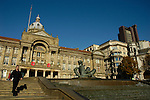 View of Council House building and nearby buildings with River fountain and statue man in the foreground Victoria Square Birmingham