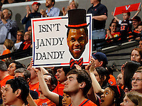 Virginia fans hold up signs during the game Saturday, February 22, 2014,  in Charlottesville, VA. Virginia won 70-49.