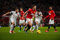 Saturday 11 January 2014 Pictured: Michael Carrick of Manchester United takes the ball throgh the swans defence<br /> Re: Barclays Premier League Manchester Utd v Swansea City FC  at Old Trafford, Manchester