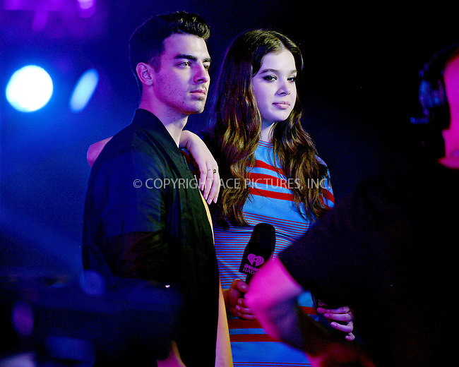 WWW.ACEPIXS.COM<br /> <br /> May 21 2016, Miami<br /> <br /> Recording artists Joe Jonas (L) and Hailee Steinfeld and perform on stage with DNCE during 2016 iHeartRadio Summer Pool Party at Fountainbleau Miami Beach on May 21, 2016 in Miami Beach, Florida.<br /> <br /> <br /> By Line: Solar/ACE Pictures<br /> <br /> <br /> ACE Pictures, Inc.<br /> tel: 646 769 0430<br /> Email: info@acepixs.com<br /> www.acepixs.com
