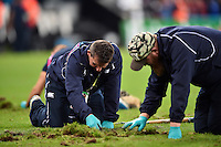 Groundsmen repair the cut up St James' Park pitch at half-time. Rugby World Cup Pool C match between New Zealand and Tonga on October 9, 2015 at St James' Park in Newcastle, England. Photo by: Patrick Khachfe / Onside Images
