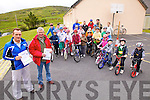 Coars NS put their cycling skills to the test on Tuesday last under the supervision of of The Cahersiveen/Killorglin Credit Union Cycling Club as part of National Bike Week.  Principal of Coars NS Michael O'Sullivan on the left with Dan Ahern from the Cycling Club getting ready to make a presentation of certificates to the participants, the day was sponsored by Cahersiveen Credit Union.