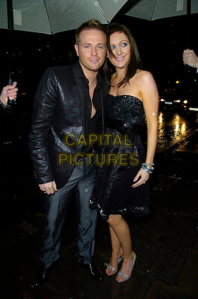 NICKY BYRNE & WIFE GEORGINA.Attend The Emeralds & Ivy Ball, Old Billingsgate Market, London, England, November 30th 2007..full length Westlife married couple black suit jacket strapless dress.CAP/CAN.©Can Nguyen/Capital Pictures