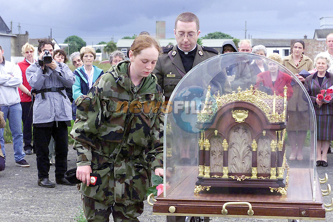 Recruit Rooney places a rose on St Theresas relic..Picture Fran Caffrey Newsfile.