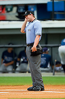 Home plate umpire Adam Beck during the Appalachian League game between the Princeton Rays and the Burlington Royals at Burlington Athletic Park on July 5, 2013 in Burlington, North Carolina.  The Royals defeated the Rays 5-1 in game one of a doubleheader.  (Brian Westerholt/Four Seam Images)