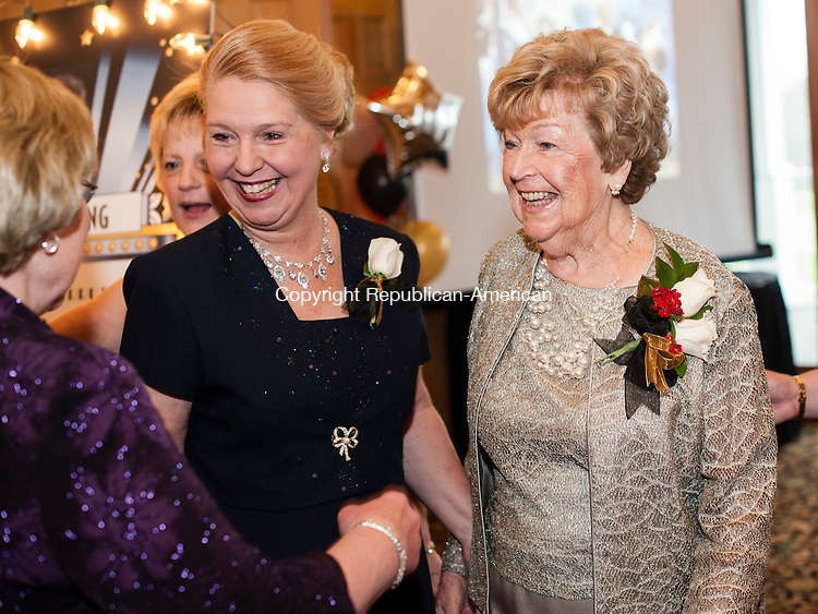 "HARWINTON, CT-2 May 2014-050214EC09-  Gladys ""Glady"" Cerruto (right) greets people at the door of the United Way of Northwest Connecticut's annual gala Friday night at Fairview Farms Golf Course in Harwinton. Next to her (left) is Deirdre DiCara with the United Way's Women's Leadership Initiative. Cerruto, 84, is a former businesswoman who ran Torrington Metal Products for decades. Cerruto was named the United Way's woman of the year. She was also the first female chairman of the board for the Northwestern Connecticut Chamber of Commerce. Erin Covey Republican-American"