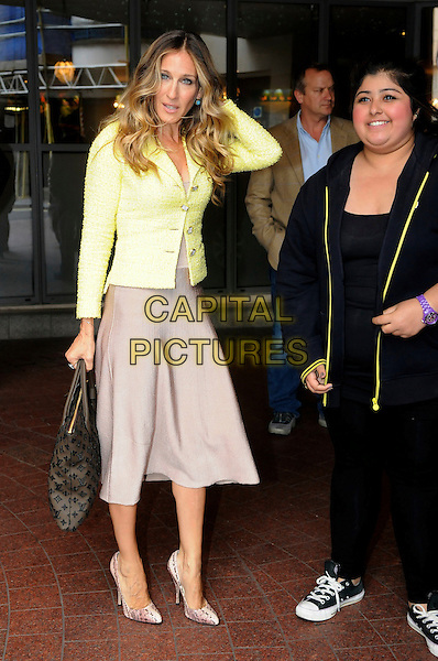 Sarah Jessica Parker leaving the Soho Hotel, London, England..August 31st, 2011.full length sjp beige skirt yellow jacket louis vuitton lv bag purse grey gray fan posing hand arm.CAP/IA.©Ian Allis/Capital Pictures.
