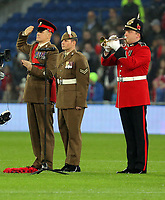 Members of the Armed Forces mark Remembrance Day before kick off during the international friendly soccer match between Wales and Panama at Cardiff City Stadium, Cardiff, Wales, UK. Tuesday 14 November 2017.