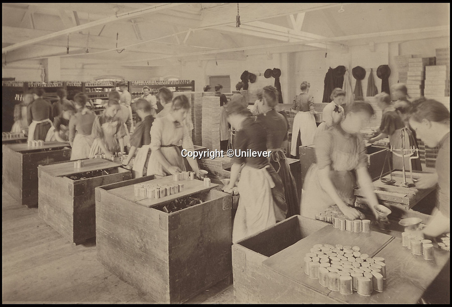 BNPS.co.uk (01202 558833)<br /> Pic: Unilever/BNPS<br /> <br /> Female workers packing penny oval tins in 1910.<br /> <br /> A staple of the British kitchen is celebrating its anniversary this year as Colman's Mustard turns 200.<br /> <br /> Archivist's research reveals the 200 year history of Colmans mustard.<br /> <br /> Founded in Norwich in 1814 by Jeremiah Colman, the super hot condiment made from Norfolk mustard seeds soon become a family favourite at dinner tables throughout the Empire, with even Capt Scott taking a case on his ill fated Terra Nova expedition to the south pole.<br /> <br /> So vital was the powdered sauce that it escaped wartime rationing to keep the home fires burning during the dark days of WW2. <br /> <br /> Despite being founded a year before Napoleon met his Waterloo, the world famous brand still produces 3000 tons of the fiery favourite every year exporting to all parts of the globe.