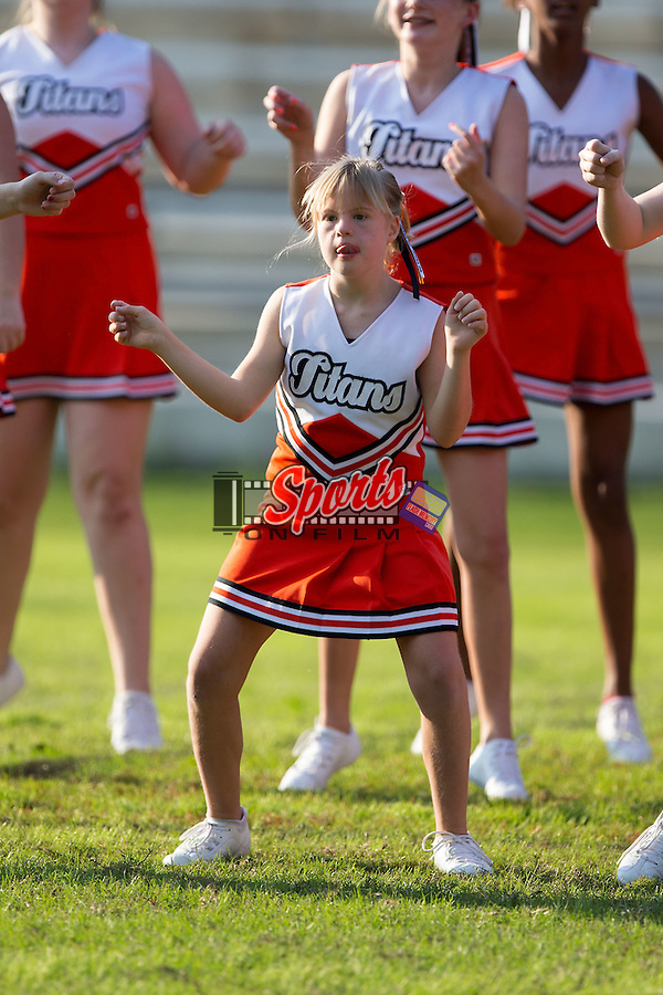 The Northwest Cabarrus Titans cheerleaders perform at half-time of the game against the Winkler Wolves at Trojan Stadium October 1, 2014, in Concord, North Carolina.  The Wolves defeated the Titans 24-22.  (Brian Westerholt/Sports On Film)