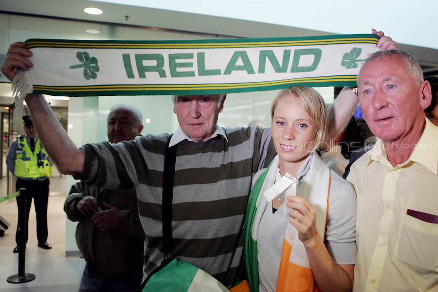 2/8/2010. Derval O'Rourke arrives back into Dublin Aiorport pictrured with Henry Gorman from Dublin and Sean Callan from Meath. European silver-medallist Derval O'Rourke has arrived home from Barcelona.O'Rourke finished second in the 100m hurdles on Saturday night to win her second European Athletics Championship silver medal. She was presented with her medal at the Olympic Stadium in Barcelona yesterday evening. Picture James Horan/Collins Photos