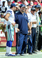 Injured Dallas Cowboys quarterback Tony Romo (9), in blue shirt and pants, discusses strategy withback-up quarterback Mark Sanchez (3) during second quarter action against the Washington Redskins at FedEx Field in Landover, Maryland on Sunday, September 18, 2016.<br /> Credit: Ron Sachs / CNP /MediaPunch