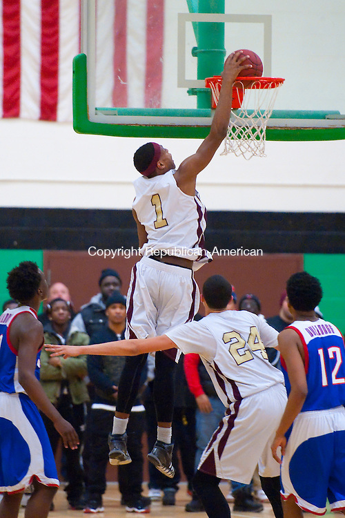 WATERBURY,  CT-030415JS11- Sacred Heart's Malik Petteway (1) slams in two of his points during their NVL Tournament championship game against Crosby Wednesday at Wilby High School in Waterbury. <br /> Jim Shannon Republican-American