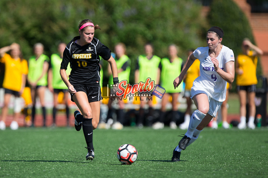 Jane Cline (10) of the Appalachian State Mountaineers keeps the ball away from Taylor Romano (4) of the High Point Panthers during first half action at Vert Track, Soccer & Lacrosse Stadium on August 26, 2016 in High Point, North Carolina.  The Panthers defeated the Mountaineers 2-0.  (Brian Westerholt/Sports On Film)
