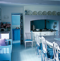 Traditional Scandinavian-style in this kitchen is personalised by a lilac-painted table top echoed by lilac and blue woodwork