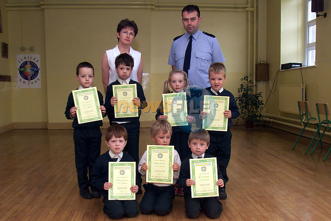 BR L to R Eoin O Cathlain, Cian O Matiu, Grace English and Tomas O hAnluain..FR  Micheal O Cathlain, Tomas O hOistin and Cathal Caomhanach, pupilc from Scoil Aonghusa pictured with their teacher Aine Ni Chuilleagain receiving their certificates for attendence from Garda Dennis Fitzpatrick..Picture: Arthur Carron/Newsfile