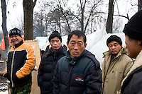ROMANIA / Bucharest / 22.02.09..Hundreds of Chinese immigrants are currently stuck in Romania after their work contracts with construction firms here were suddenly terminated in late January. They expected to make at least 800 Euros per month, or double what they can make in China as agricultural laborers. About 80 of them are camped out under plastic sheeting in front of the Chinese Embassy hoping to get some kind of help. During the day, hundreds more are joining them to stage a protest. They paid a Chinese broker 10,000 Euros a piece for the lucrative four year construction contracts and are hoping to get reimbursed in order to be able to buy tickets home. The immigrants are relying upon the help of generous Romanians who pull up and deliver food from their cars. The economic crisis hit Romania just as many of the immigrants arrived in November. ..© Davin Ellicson / Anzenberger