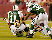 Landover, MD - August 19, 2006 -- New York Jets quarterback Patrick Ramsey (11) is sacked on the first play of the preseason game against the Washington Redskins by corner back Kenny Wright (25) at FedEx Field in Landover, Maryland, Saturday, August 19, 2006.<br />