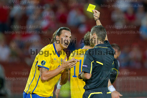 Sweden's Zlatan Ibrahimovic (L) argues about his penalty during the UEFA EURO 2012 Group E qualifier Hungary playing against Sweden in Budapest, Hungary on September 02, 2011. ATTILA VOLGYI