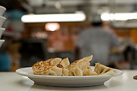Gyoza or potsicker dumplings are served at a noodle and dumpling restaurant in Shibuya Tokyo.